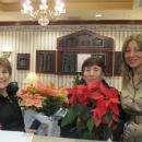 Family Holiday Brunch guests with Board President Eleni Bousis